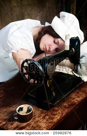 The sleeping young seamstress after wearisome work