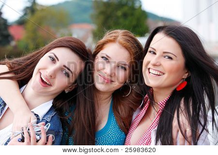 Portrait happy young and attractive girlfriends