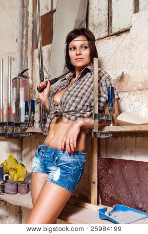 Portrait sexy girl in the carpentry shop carpenters