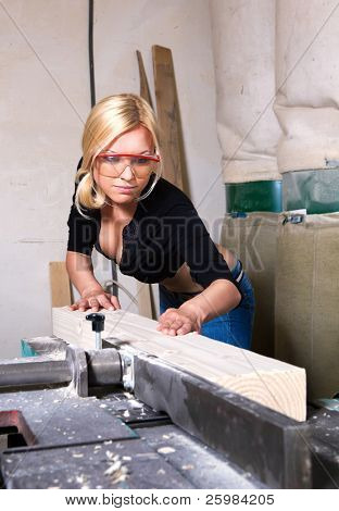 beautiful girl working in the carpentry shop