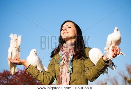 The happy teen releasing a pigeons
