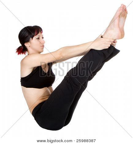 Young woman doing floor exercise, studio shut