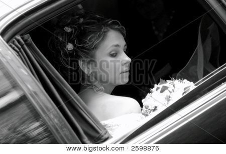 Bride In Wedding Car Limousine