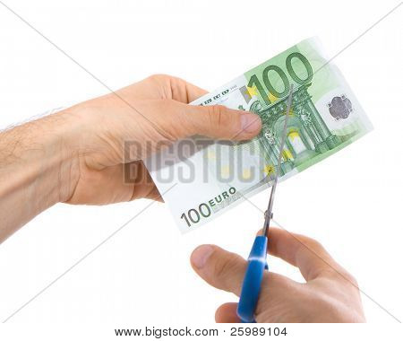 a bill of 100 euro being cut in two with scissors isolated on white background