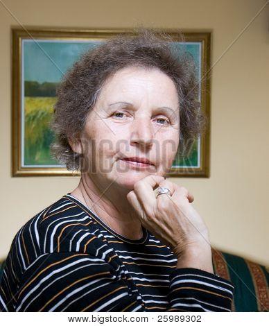 Gracious senior lady portrait inside