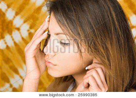 Portrait of attractive young woman with headache