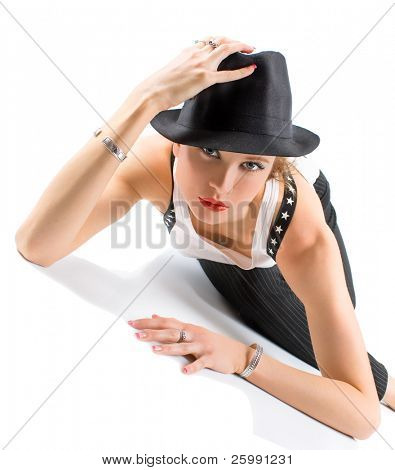 Photo-session in studio of the young blondy girl with black hat