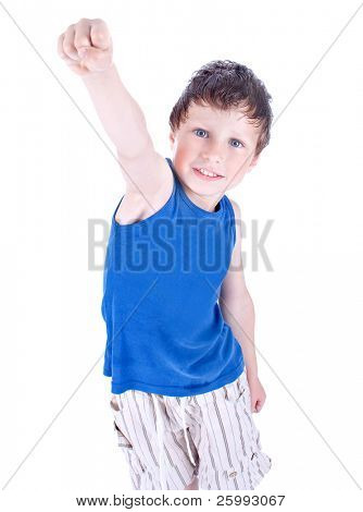 A child with his arm in the air like superman, studio shot