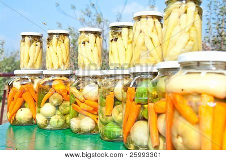 Jar of winter provisions ,hot paprika, carrot, green tomato, parsley with paper in vinegar