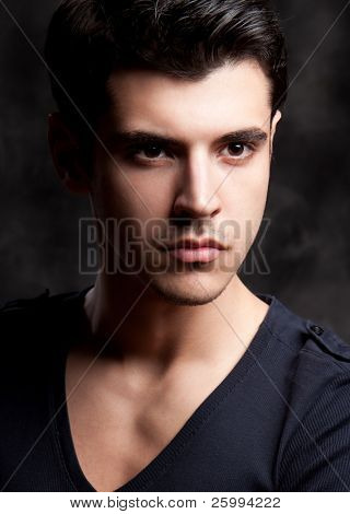Close up Fashion Shot of a Young Man. A trendy European man dressed in contemporary cloth. He is now a professional model.