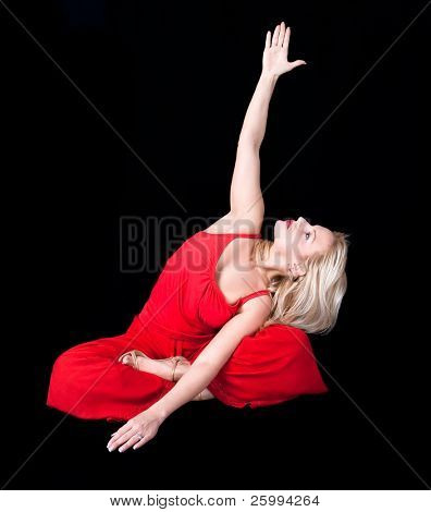 Business woman doing joga at lunch break ,  isolated on black