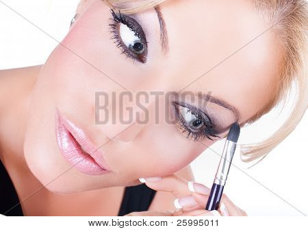 Closeup portrait of a pretty young woman using creyon