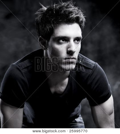 Fashion Shot of a macho Man in black and white.  He is now a professional model.