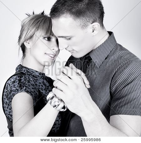 Elegant and happy romantic dancing couple , black and white shot