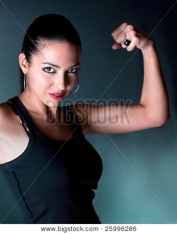 Beautiful woman show your bicep  , studio shot