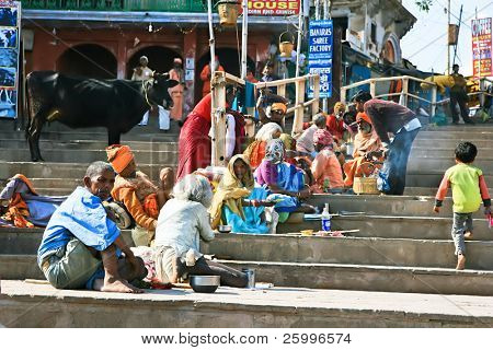 VARANASI, INDIA - 13 FEBRUARY: Beggars sitting on the steps and waiting alms, , banks of Ganga river, Main Ghat in holy Varanasi,  Uttar Pradesh, on  February 13, 2008 in Varanasi, India.