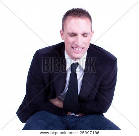 Businessman in pain holding his stomach, isolated on white
