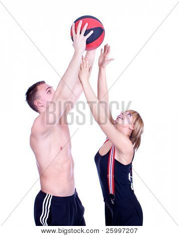 young couple over white with basketball ball , studio shot