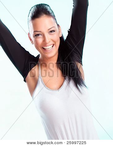 Champion woman standing with hand up  in victory. Studio shot