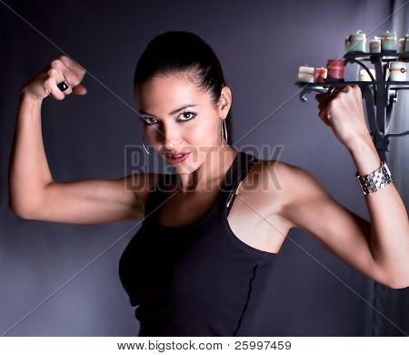 Beautiful woman show your biceps  , studio shot