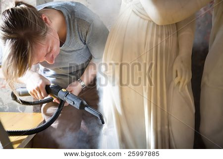 VIENNA, AUSTRIA - MAY 20: Woman restoring a marble  statue in Kunsthistorisches museum on 20 May 2010 in Vienna, Austria