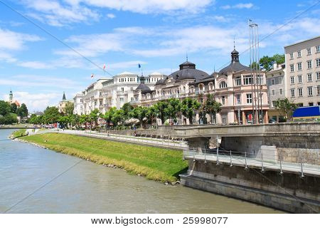 Elegant buildings line the Salzach River, downtown Salzburg, Austria.