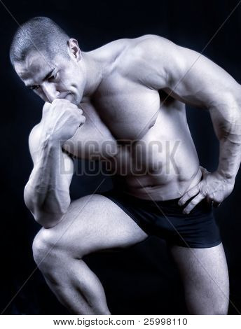 The Perfect muscular man posing , black and white shot