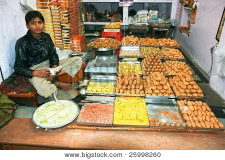 AGRA, INDIA - FEBRUARY 22:Vendor always sits in lotus position while sells goods in Indian shops. February 22, 2008.Agra, India.