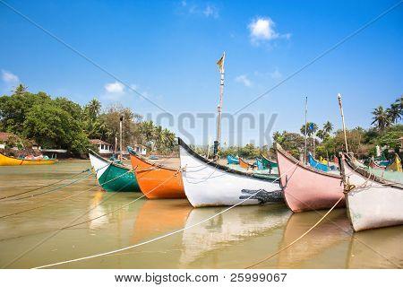 Wooden outrigger fishing boats  on delta of  Baga river at Calangute beach, Goa, India