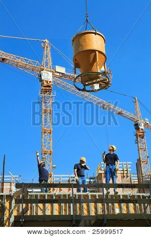 VIENNA, AUSTRIA - MAY 25: Group of the workers with cement plant all day make a new building in center of Vienna, 25 May 2010 in Vienna , Austria