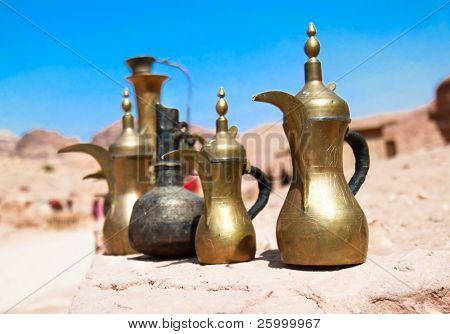 Typical vintage metal teapots in bedouin cafe in Petra, Jordan