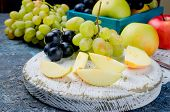 Fresh Yellow Apples, White And Blue Grapes, Scattered On The  Table, Slice Fruits And Fruit Leather  poster
