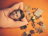 Red-haired Man Lies On An Orange Background. Autumn Mood And The Weather Are Warm And Sunny And Rain poster