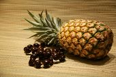 image of kukui nut  - a fresh pineapple with a  - JPG