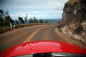 picture of pch  - view of maui from a convertiable rental car with  - JPG