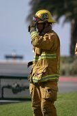 LAGUNA BEACH, CA - FEB 19: Firefighter recruit takes a break during fire fighting drills at the loca