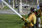 LAGUNA BEACH, CA - FEB 19: Firefighter recruit sprays water during fire fighting drills at the local