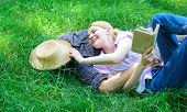 Man And Girl Lay On Green Grass Having Fun. Couple In Love Spend Leisure Reading Book. Couple Soulma poster