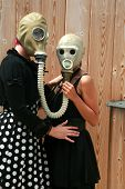 foto of poka dot  - two young women wear gas masks connected to each other for a unique photograph - JPG