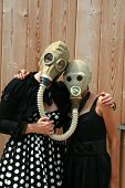 pic of poka dot  - two young women wear gas masks connected to each other for a uniqe photograph - JPG