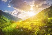 Sunny Mountains Landscape. Mountain Range And Yellow Sunlight On Grassy Hills. Amazing Sunset In Hig poster