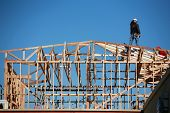 image of 2x4  - unidentifiable construction workers work on framing a building - JPG