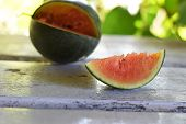 A Slice Of Juicy Fresh Mini Watermelon At A Light Wooden Background/ Mini Watermelon poster