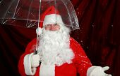 foto of 24th  - Santa Claus holds his transparent umbrella and checks for signs of snow before he goes to work on December 24th Christmas Eve - JPG
