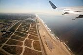 Leaving Los Angeles airport in an airplane aka LAX and flying over the pacific ocean on the way to M