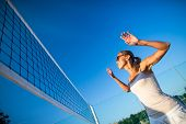 Beach Volleyball Game - Pretty, young woman playing volleyball outdoors poster