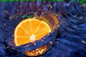 stock photo of crown green bowls  - Bit of lemon dropped to pure water - JPG