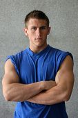 picture of muscle man  - Sexy muscular man in a blue t - JPG