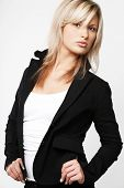 stock photo of blonde woman  - Blond businesswoman in black suit - JPG