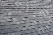 Grey Asphalt Roof Shingles Textured Surface As Abstract Background. poster